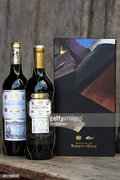 Marques de Riscal Rioja red wine bottles Gran Reserva 2004 and Reserva 2007 vintage by old oak panel Spain