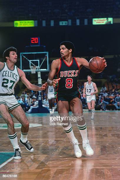 Marques Johnson of the Milwaukee Bucks moves the ball up court against Kevin Stacom of the Boston Celtics during a game played in 1978 at the Boston...