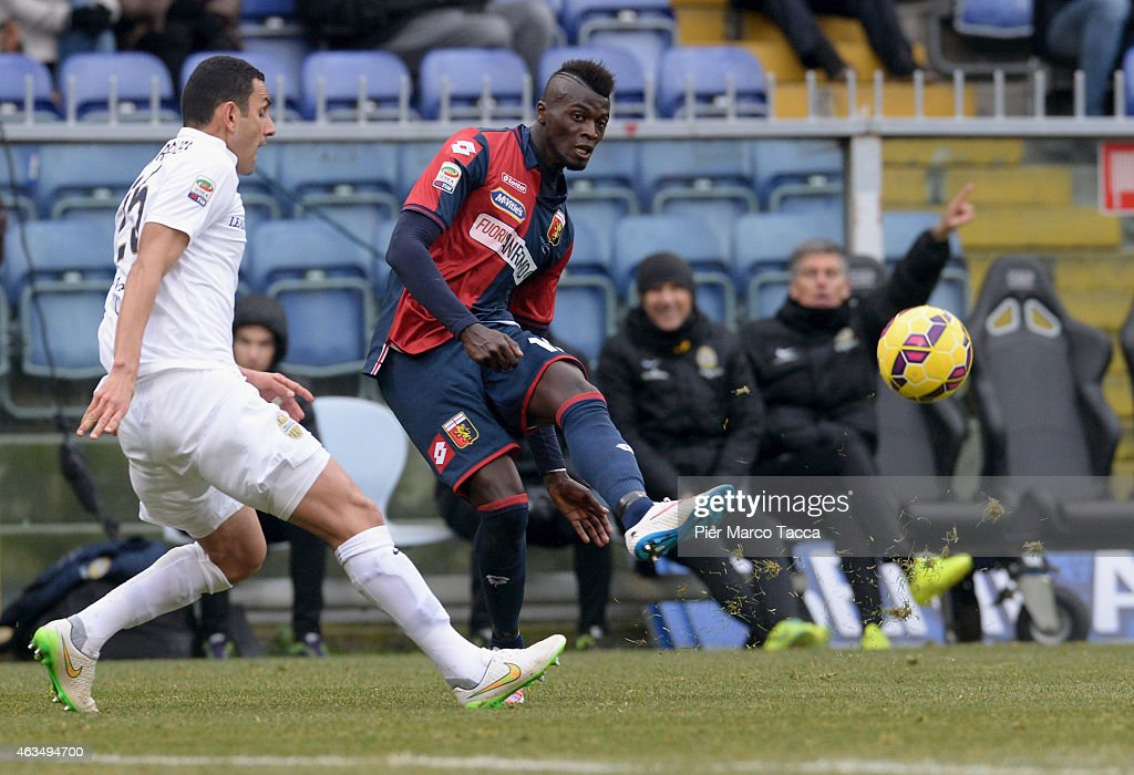 Marques Pinto Rafael of Hellas Verona FC competes for the ball with M'baye Niang of Genoa CFC during the Serie A match between Genoa CFC and Hellas Verona FC at Stadio Luigi Ferraris on February 15, 2015 in Genoa, Italy.