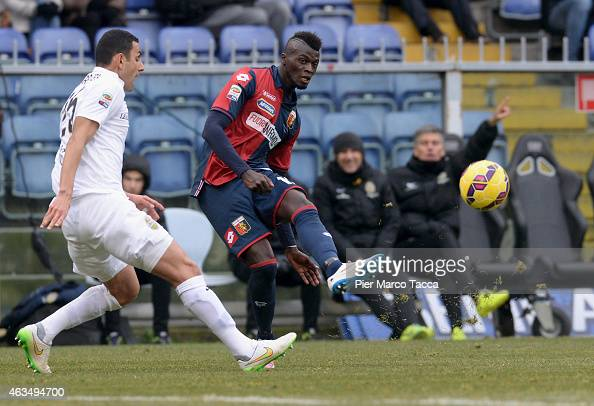 Marques Pinto Rafael of Hellas Verona FC competes for the ball with M'baye Niang of Genoa CFC during the Serie A match between Genoa CFC and Hellas...