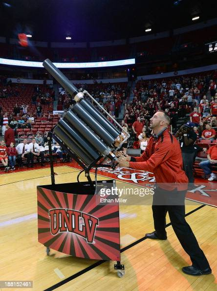 Marques Plaff fires the Runnin' Gun Tshirt cannon before a game between the NebraskaOmaha Mavericks and the UNLV Rebels at the Thomas Mack Center on...