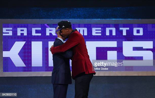 Marquese Chriss hugs Commissioner Adam Silver after being drafted eighth overall by the Sacramento Kings in the first round of the 2016 NBA Draft at...