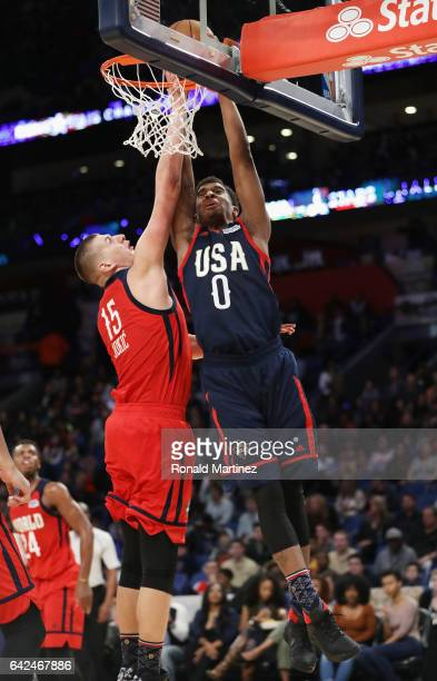 Marquese Chriss of the Phoenix Suns attempts to dunk the ball against Nikola Jokic of the Denver Nuggets in the second half of the 2017 BBVA Compass...