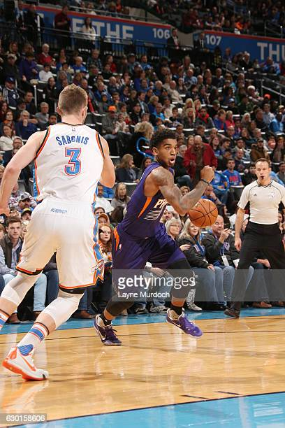 Marquese Chriss of the Phoenix Suns drives to the basket against Domantas Sabonis of the Oklahoma City Thunder during the game on December 17 2016 at...