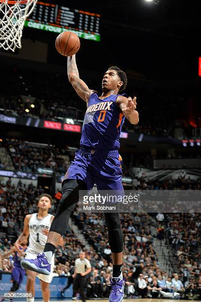 Marquese Chriss of the Phoenix Suns goes for the dunk during the game against the San Antonio Spurs on December 28 2016 at the ATT Center in San...