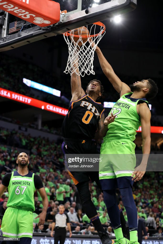 Marquese Chriss #0 of the Phoenix Suns goes up for a dunk against the Minnesota Timberwolves on December 16, 2017 at Target Center in Minneapolis, Minnesota.