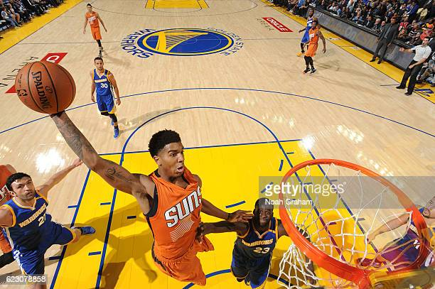 Marquese Chriss of the Phoenix Suns goes up for a dunk during a game against the Golden State Warriors on November 13 2016 at ORACLE Arena in Oakland...