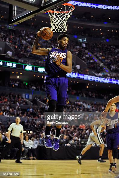 Marquese Chriss of the Phoenix Suns grabs a rebound against the San Antonio Spurs as part of NBA Global Games at Arena Ciudad de Mexico on January 14...
