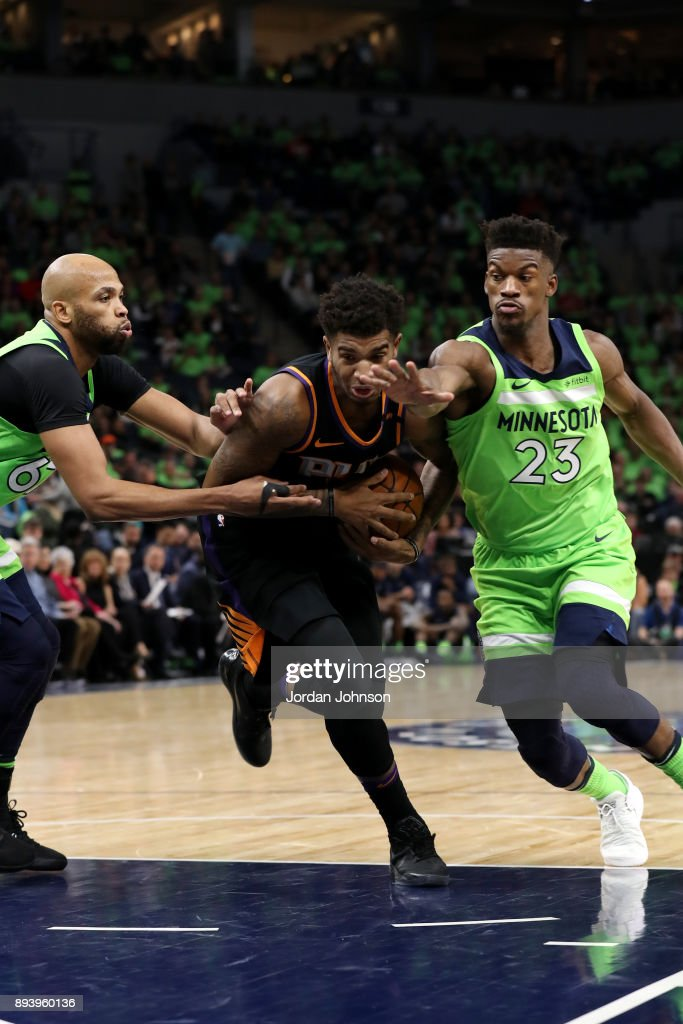Marquese Chriss #0 of the Phoenix Suns handles the ball against the Minnesota Timberwolves on December 16, 2017 at Target Center in Minneapolis, Minnesota.