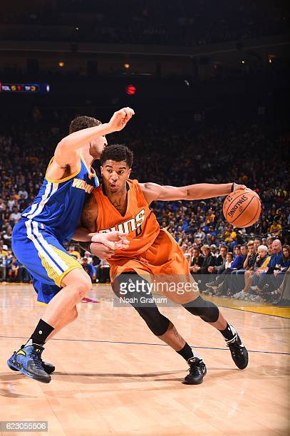 Marquese Chriss of the Phoenix Suns handles the ball during a game against the Golden State Warriors on November 13 2016 at ORACLE Arena in Oakland...