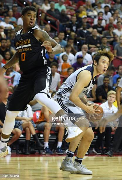 Marquese Chriss of the Phoenix Suns jumps by Ding Yanyuhang of the Dallas Mavericks during the 2017 Summer League at the Thomas Mack Center on July 9...