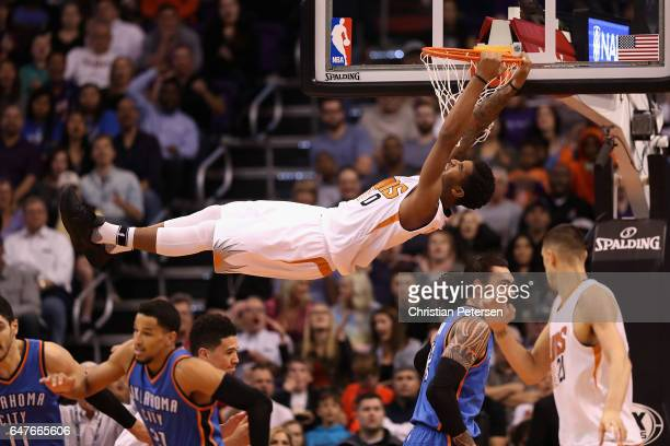 Marquese Chriss of the Phoenix Suns slam dunks the ball against the Oklahoma City Thunder during the first half of the NBA game at Talking Stick...