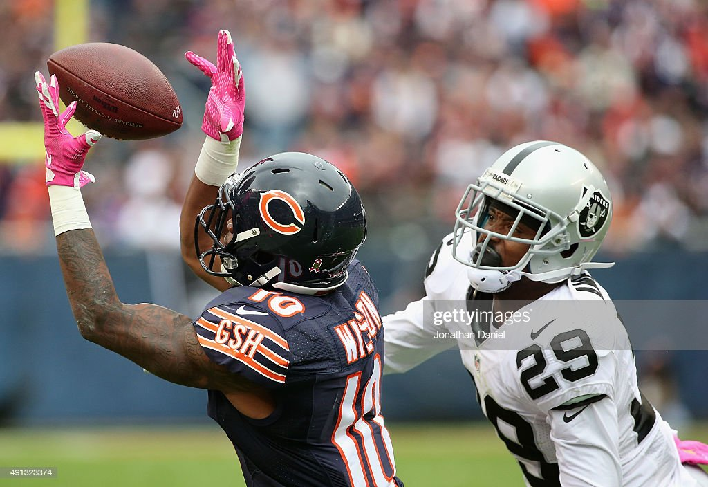 <a gi-track='captionPersonalityLinkClicked' href=/galleries/search?phrase=Marquess+Wilson&family=editorial&specificpeople=7296805 ng-click='$event.stopPropagation()'>Marquess Wilson</a> #10 of the Chicago Bears hauls in a pass on the last Bears possession of the game in front of <a gi-track='captionPersonalityLinkClicked' href=/galleries/search?phrase=David+Amerson&family=editorial&specificpeople=7244765 ng-click='$event.stopPropagation()'>David Amerson</a> #29 of the Oakland Raiders at Soldier Field on October 4, 2015 in Chicago, Illinois. The Bears defeated the Raiders 22-20.