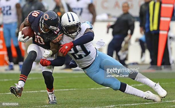 Marquess Wilson of the Chicago Bears is hit by Da'Norris Searcy of the Tennessee Titans after catching a pass at Soldier Field on November 27 2016 in...