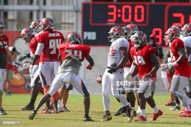 Marqueston Huff throws a right hook at Jeremy McNichols who steps back away from the punch during the Tampa Bay Buccaneers Training Camp on AUG 23...