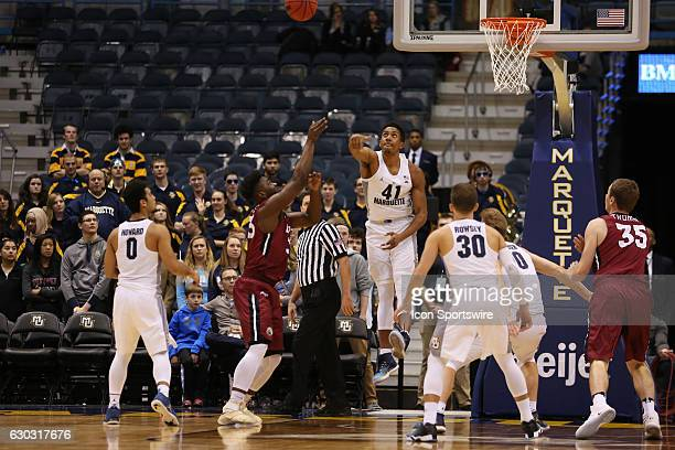 Marquette Golden Eagle forward Deon Franklin blocks a shot during the NCAA men's basketball game between the IUPUI Jaguars and the Marquette Golden...