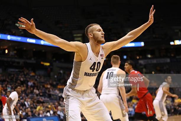 Marquette Golden Eagles center Luke Fischer plays defense during an NCAA basketball game between Marquette Golden Eagles and Fresno State Bulldogs on...