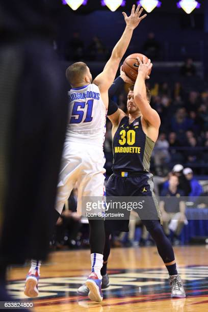 Marquette Golden Eagles guard Andrew Rowsey controls the ball against DePaul Blue Demons guard Chris HarrisonDocks in the first half during a game...