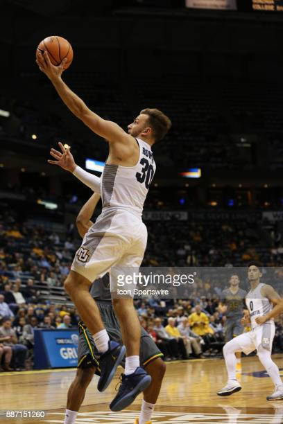Marquette Golden Eagles guard Andrew Rowsey drives the lane during a game between the Marquette Golden Eagles and the Vermont Catamounts at the BMO...