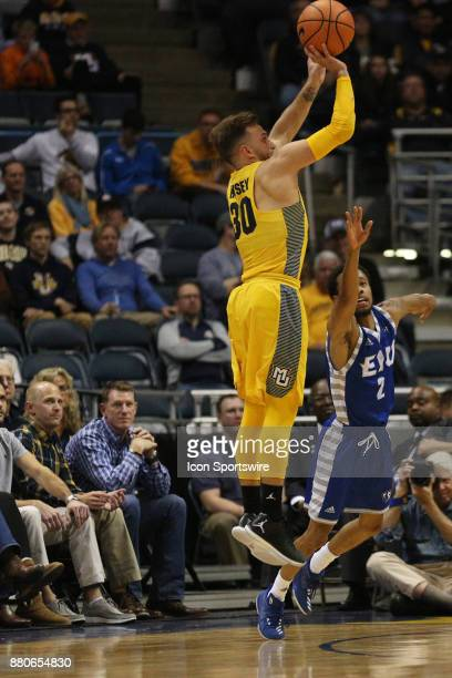 Marquette Golden Eagles guard Andrew Rowsey shoots a three pointer during a game between the Marquette Golden Eagles and the Eastern Illinois...