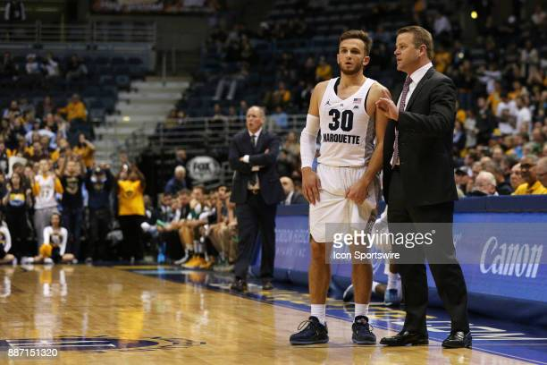 Marquette Golden Eagles guard Andrew Rowsey talks with Marquette Golden Eagles head coach Steve Wojciechowski during a game between the Marquette...