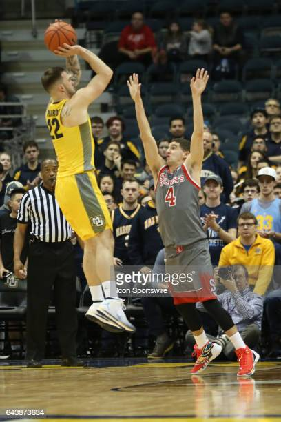 Marquette Golden Eagles guard Katin Reinhardt shoots over St John's Red Storm guard Federico Mussini during the Big East Conference game between the...