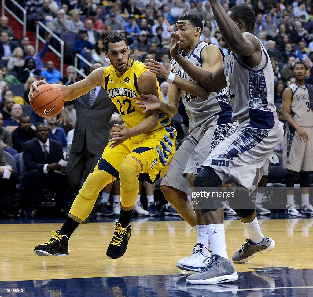 Marquette guard Trent Lockett (22) is forced to reverse his dribble against Georgetown forward Otto Porter Jr. (22) and Georgetown center Moses Ayegba (32), right, in the first half at the Verizon Center in Washington, D.C., Monday, February 11, 2013.