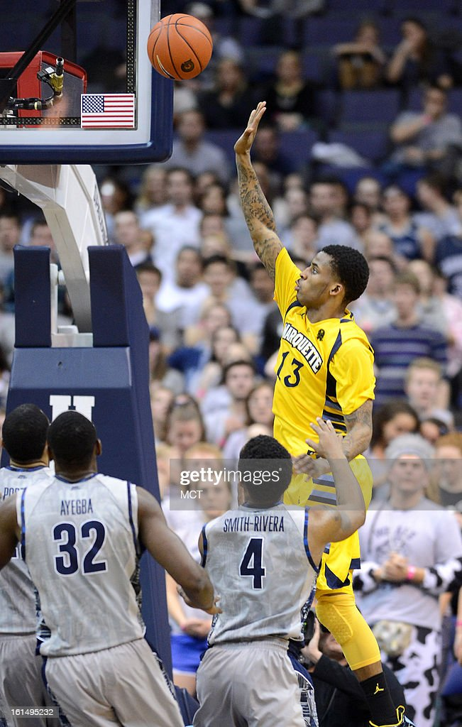 Marquette guard Vander Blue (13) lofts up a shot over three Georgetown defenders in the second half at the Verizon Center in Washington, D.C., Monday, February 11, 2013. Georgetown defeated Marquette, 63-55.
