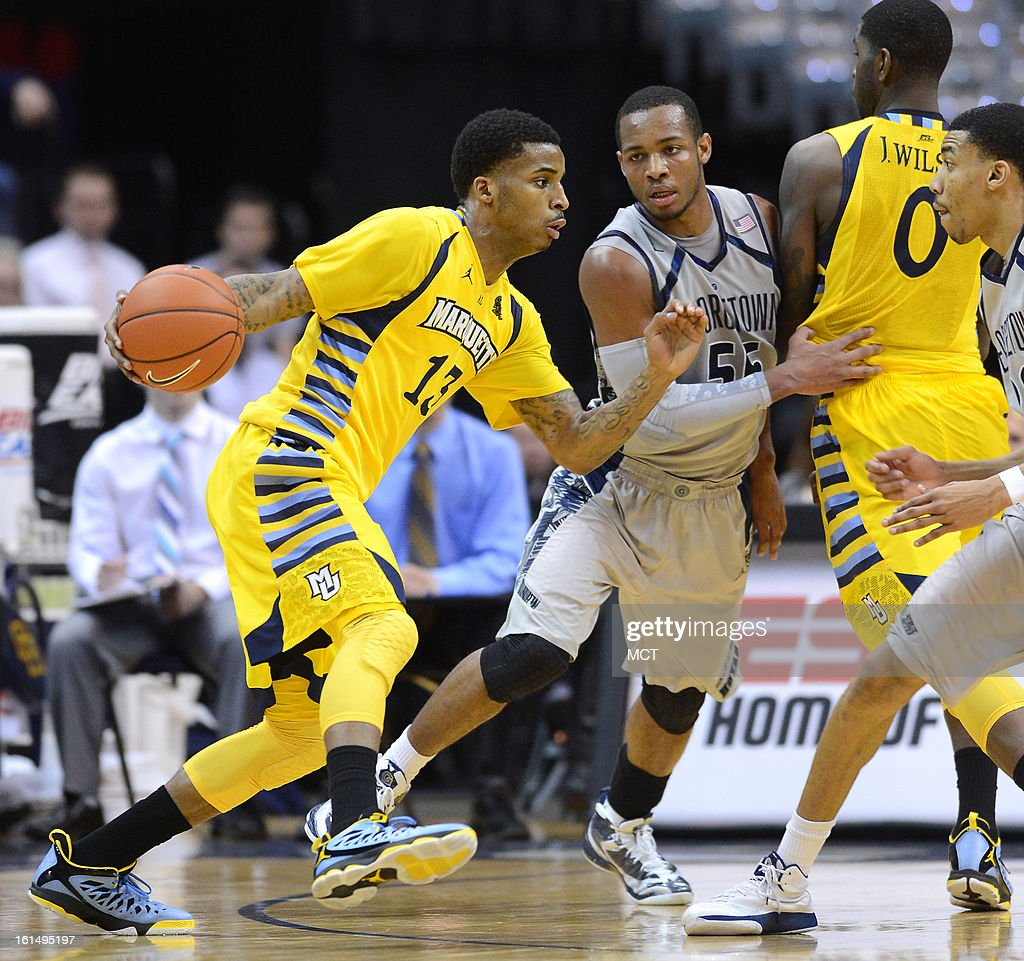 Marquette guard Vander Blue (13) uses a screen by Marquette forward Jamil Wilson (0) to block Georgetown defender Jabril Trawick (55) in the second half at the Verizon Center in Washington, D.C., Monday, February 11, 2013. Georgetown defeated Marquette, 63-55.