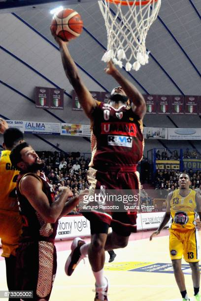 MarQuez Haynes and Mitchell Watt of Umana competes with Diante Maurice Garrett and Lamar Patterson during the LBA LegaBasket of Serie A match between...