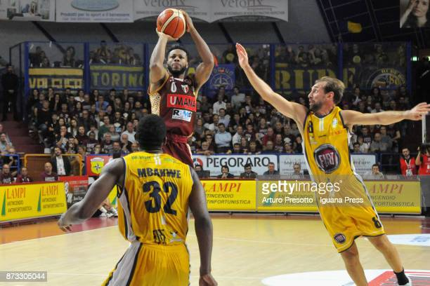 MarQuez Haynes of Umana competes with Trevor Mbakwe and Giuseppe Poeta during the LBA LegaBasket of Serie A match between Reyer Umana Venezia and...