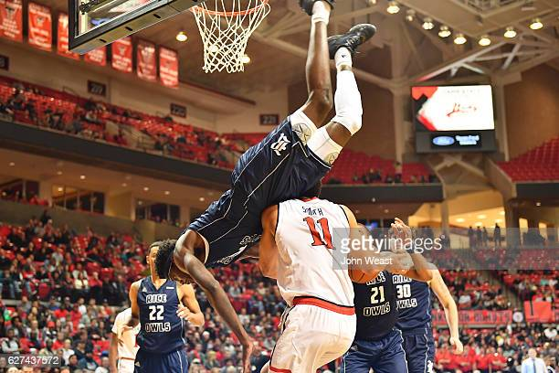 Marquez LetcherEllis of the Rice Owls falls over Zach Smith of the Texas Tech Red Raiders during the the game on December 03 2016 at United...