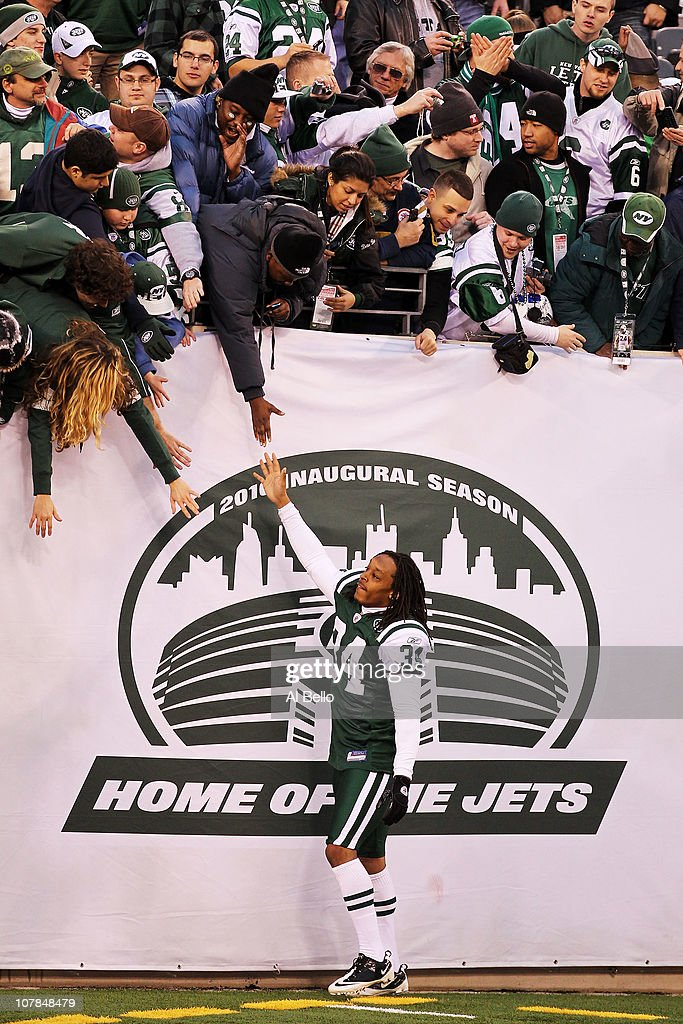 Marquice Cole #34 of the New York Jets celebrates with fans after they defeated the Buffalo Bills 38 to 7 at New Meadowlands Stadium on January 2, 2011 in East Rutherford, New Jersey.