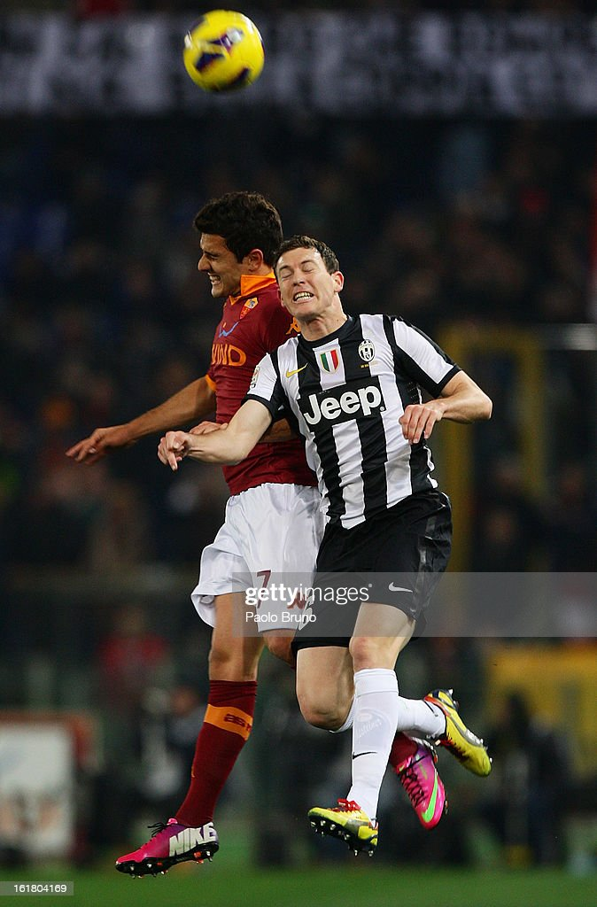 Marquinho (L) of AS Roma competes for the ball with Stephan Lichtsteiner of Juventus FC during the Serie A match between AS Roma and Juventus FC at Stadio Olimpico on February 16, 2013 in Rome, Italy.