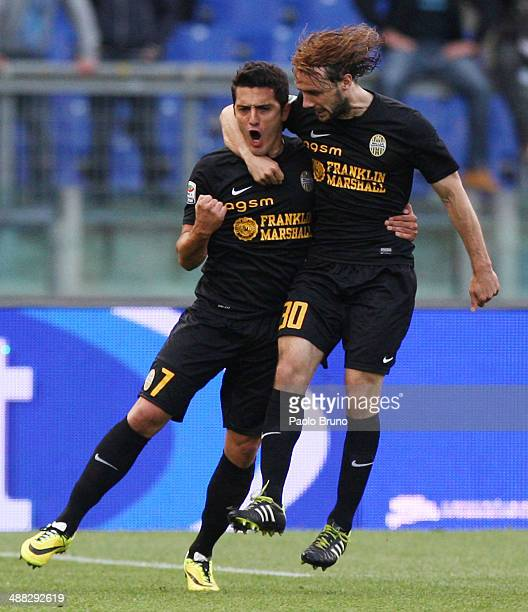 Marquinho with his teammate Marco Donadel of Hellas Verona celebrates after scoring the first team's goal during the Serie A match between SS Lazio...