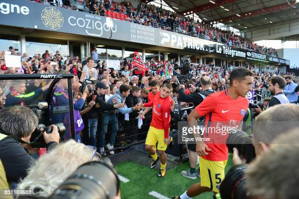 Marquinhos Marco Verratti and Thiago Motta of PSG come out for the warm up before the Ligue 1 match between EA Guingamp and Paris Saint Germain at...