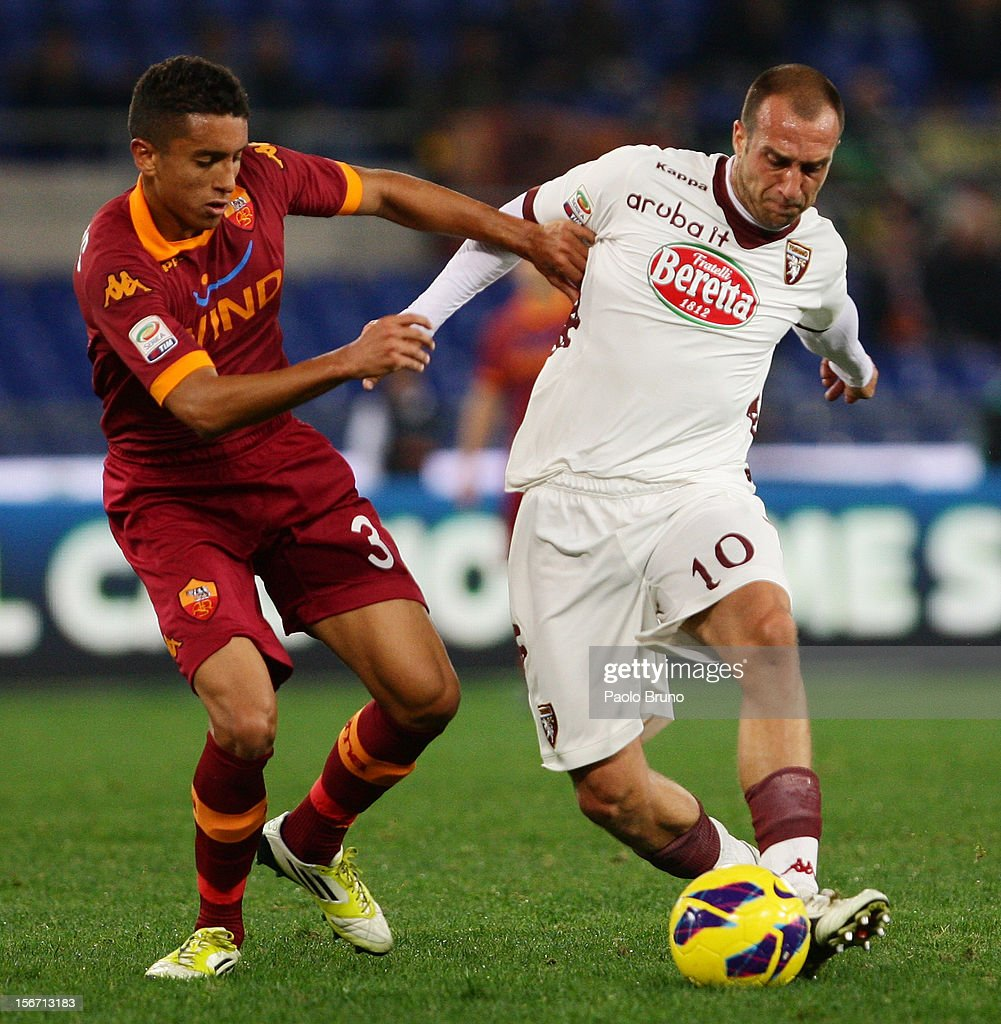 Marquinhos (L) of AS Roma competes for the ball with Alessandro Sgrigna of Torino FC during the Serie A match between AS Roma and Torino FC at Stadio Olimpico on November 19, 2012 in Rome, Italy.