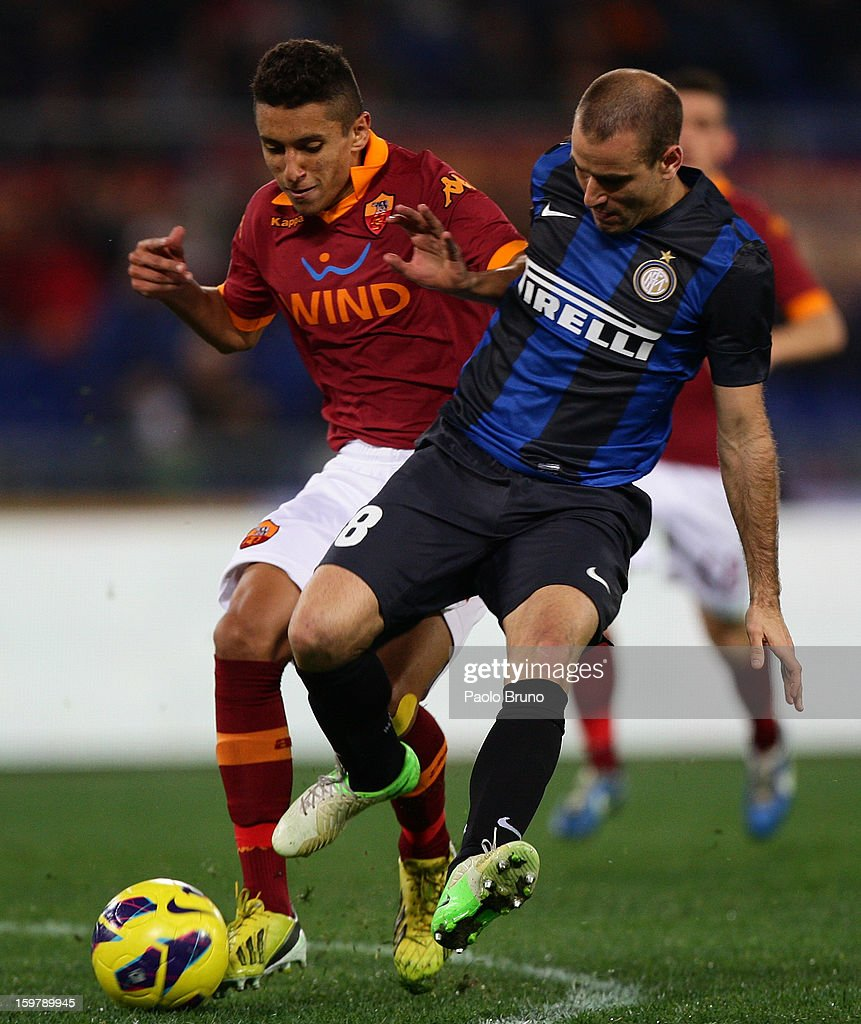 Marquinhos (L) of AS Roma competes for the ball with <a gi-track='captionPersonalityLinkClicked' href=/galleries/search?phrase=Rodrigo+Palacio&family=editorial&specificpeople=490993 ng-click='$event.stopPropagation()'>Rodrigo Palacio</a> of FC Internazionale Milano during the Serie A match between AS Roma and FC Internazionale Milano at Stadio Olimpico on January 20, 2013 in Rome, Italy.