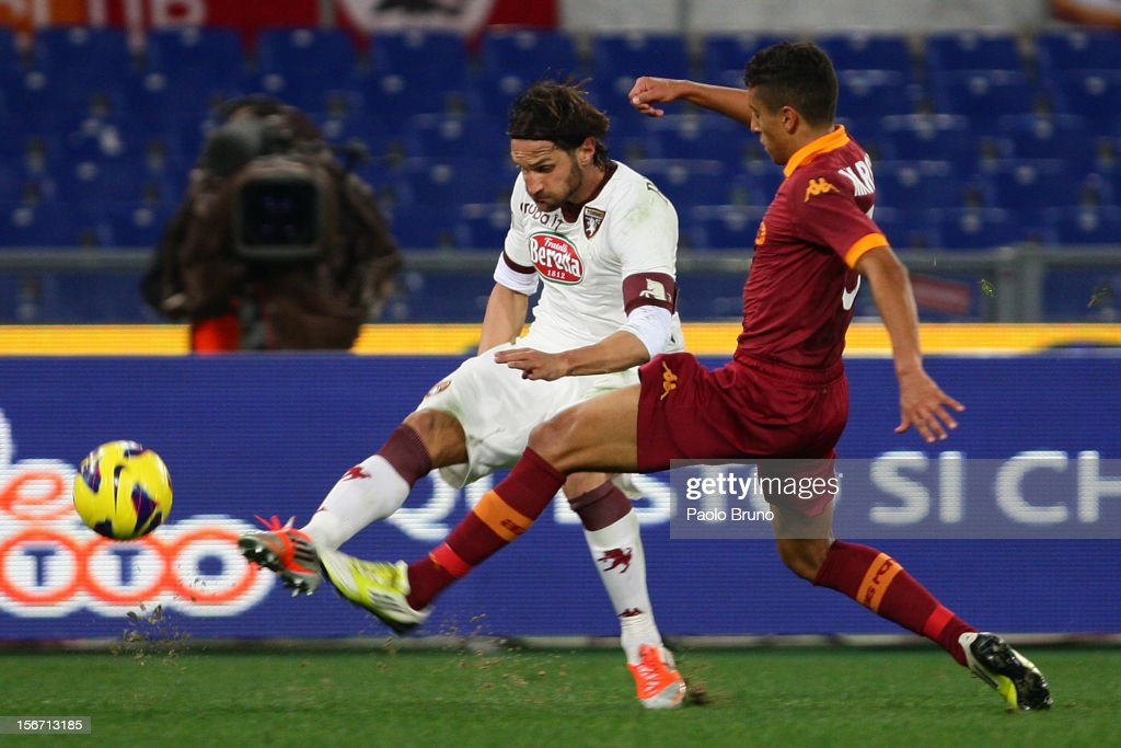 Marquinhos (R) of AS Roma competes for the ball with <a gi-track='captionPersonalityLinkClicked' href=/galleries/search?phrase=Rolando+Bianchi&family=editorial&specificpeople=605847 ng-click='$event.stopPropagation()'>Rolando Bianchi</a> of Torino FC during the Serie A match between AS Roma and Torino FC at Stadio Olimpico on November 19, 2012 in Rome, Italy.