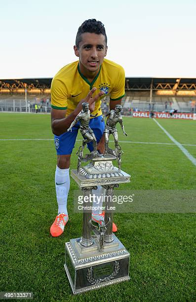 Marquinhos of Brazil celebrates their victory with the trophy during the Final of the Toulon Tournament between France and Brazil at the Parc des...