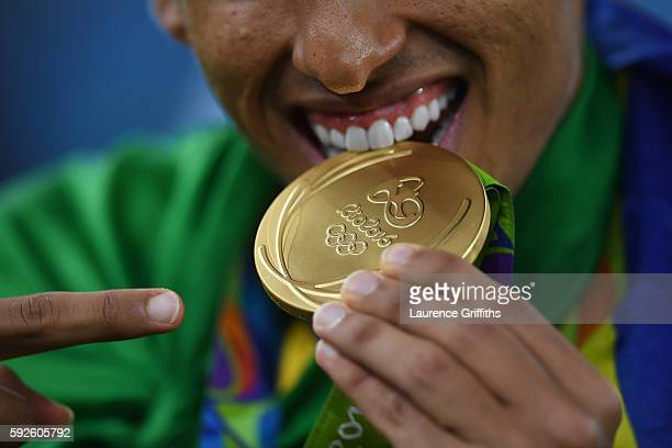 Marquinhos of Brazil celebrates with his gold medal following the Men's Football Final between Brazil and Germany at the Maracana Stadium on Day 15...
