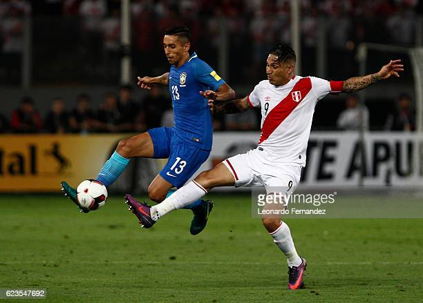 Marquinhos of Brazil fights for the ball with Paolo Guerrero of Peru during a match between Peru and Brazil as part of FIFA 2018 World Cup Qualifiers...