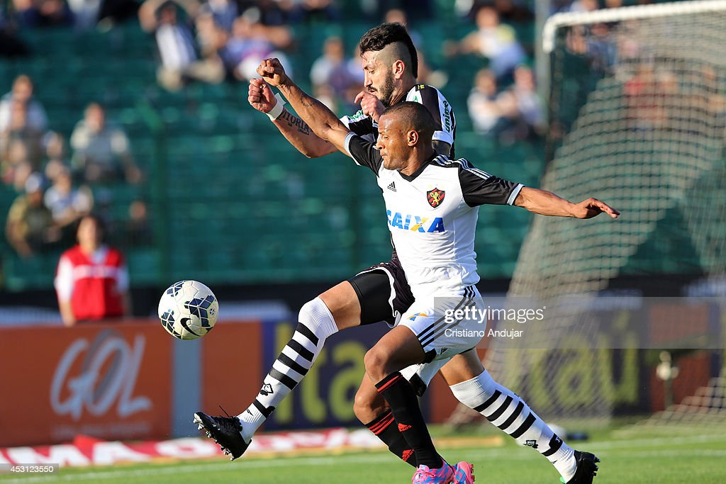 Marquinhos #3 of Figueirense fight for the ball with Patric #12 of Sport during a match between Figueirense and Sport as part of Campeonato Brasileiro 2014 at Orlando Scarpelli Stadium on August 3, 2014 in Florianopolis, Brazil
