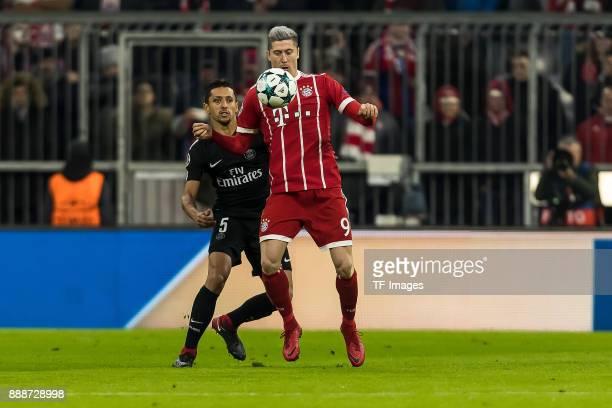 Marquinhos of Paris SaintGermain and Robert Lewandowski of Bayern Muenchen battle for the ball during the UEFA Champions League group B match between...