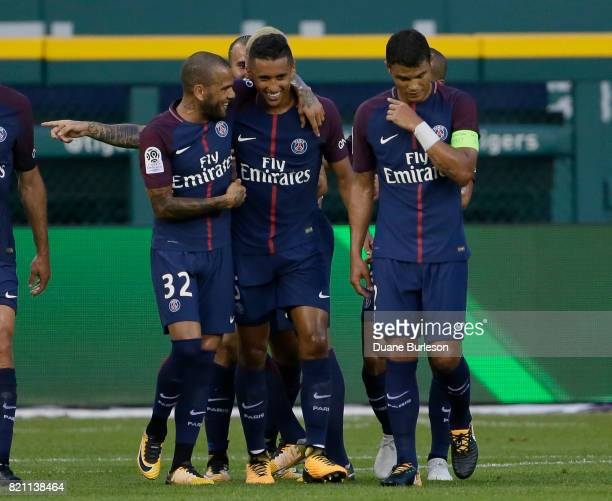 Marquinhos of Paris SaintGermain celebrates his goal with Dani Alves of Paris SaintGermain and Thiago Silva of Paris SaintGermain during the first...