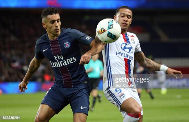 Marquinhos of PSG and Memphis Depay of Lyon in action during the French Ligue 1 match between Paris SaintGermain and Olympique Lyonnais at Parc des...