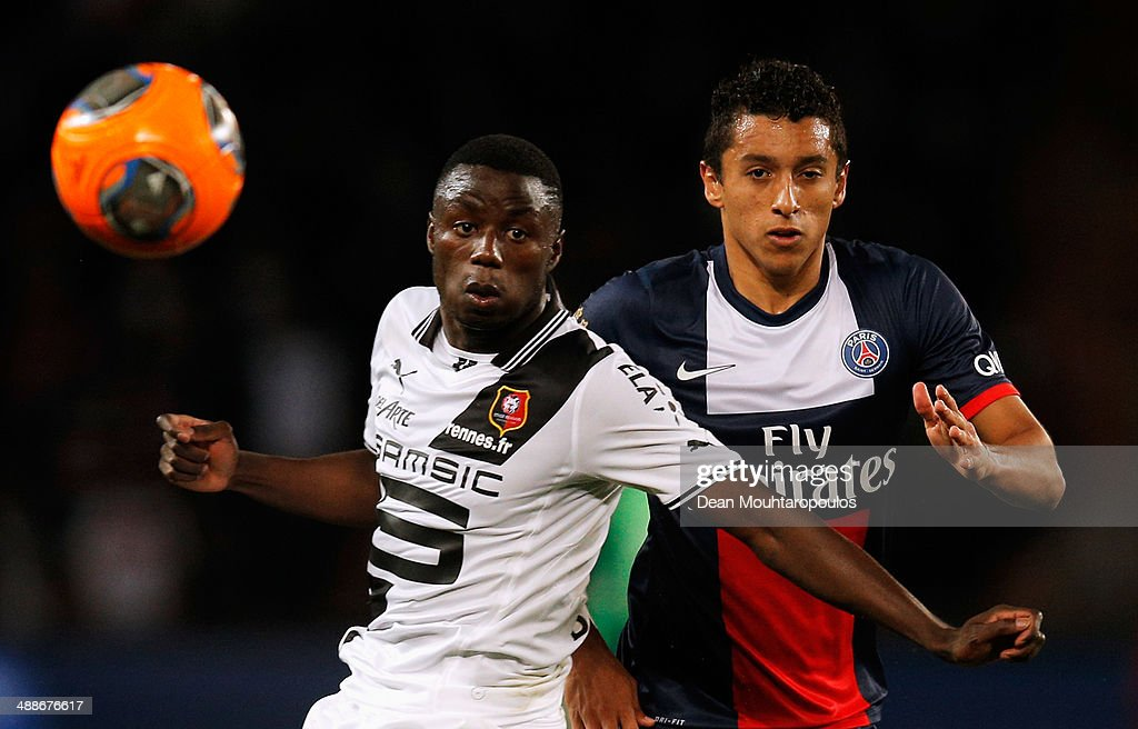 Marquinhos of PSG and PaulGeorges Ntep de Madiba of Rennais battle for the ball during the Ligue 1 match between Paris SaintGermain FC and Stade...