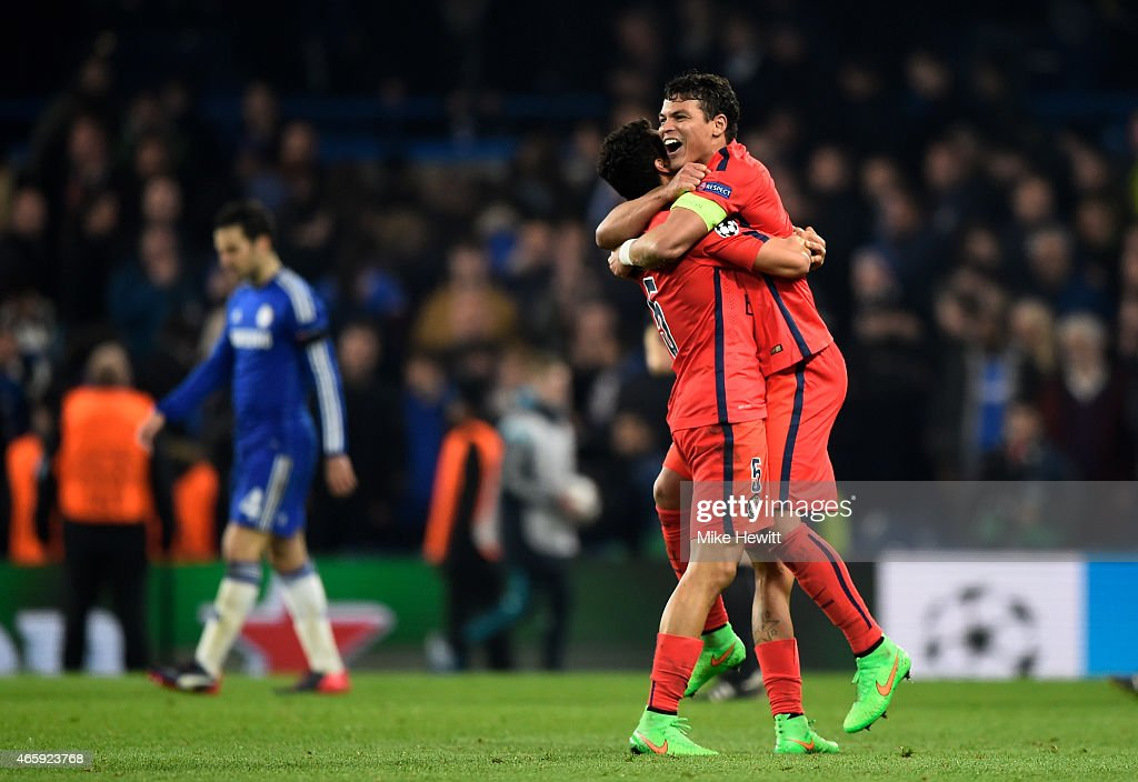 Marquinhos of PSG and Thiago Silva of PSG celebrate following their team's victory during the UEFA Champions League Round of 16, second leg match between Chelsea and Paris Saint-Germain at Stamford Bridge on March 11, 2015 in London, England.
