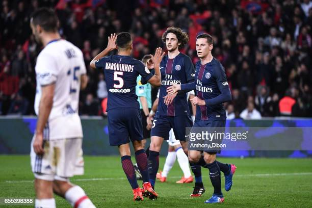 Marquinhos of PSG celebrates a goal with Adrien Rabiot and Julian Draxler of PSG during the French Ligue 1 match between Paris Saint Germain and Lyon...