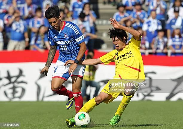 Marquinhos of Yokohama FMarinos and Daisuke Suzuki of Kashiwa Reysol compete for the ball during the Yamazaki Nabisco Cup semi final second leg match...